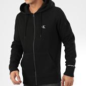 /achat-sweats-zippes-capuche/calvin-klein-jeans-sweat-zippe-capuche-4535-noir-205046.html