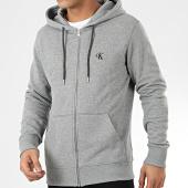/achat-sweats-zippes-capuche/calvin-klein-jeans-sweat-zippe-capuche-4535-gris-chine-205047.html