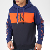 /achat-sweats-capuche/calvin-klein-jeans-sweat-capuche-blocking-statement-logo-4121-bleu-marine-orange-206376.html