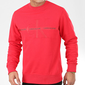 /achat-sweats-col-rond-crewneck/calvin-klein-jeans-sweat-crewneck-taping-through-monogram-4127-rouge-206378.html