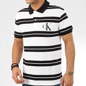 /achat-polos-manches-courtes/calvin-klein-polo-manches-courtes-a-rayures-big-monogram-striped-5193-blanc-noir-208063.html
