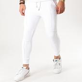 /achat-pantalons-joggings/uniplay-pantalon-jogging-pns-10-blanc-208755.html