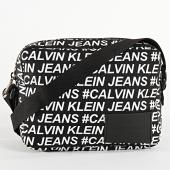 /achat-sacs-sacoches/calvin-klein-sacoche-femme-sport-essentials-6812-noir-209038.html