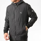 /achat-vestes/calvin-klein-jeans-veste-zippee-capuche-blocking-nylon-4853-noir-211765.html