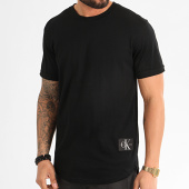 /achat-t-shirts-longs-oversize/calvin-klein-jeans-tee-shirt-oversize-badge-turn-up-5319-noir-211787.html