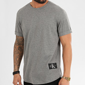 /achat-t-shirts-longs-oversize/calvin-klein-jeans-tee-shirt-oversize-badge-turn-up-5319-gris-chine-211788.html