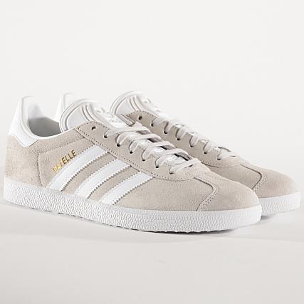 reputable site bbe39 eedd2 adidas - Baskets Gazelle F34053 Grey One Footwear White Gold Metallic -  LaBoutiqueOfficielle.com