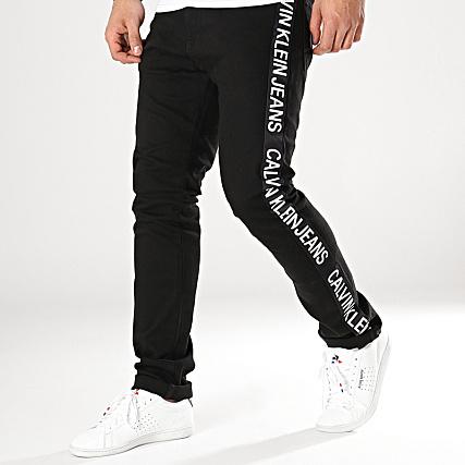 a60c1d7060c Calvin Klein - Jean Slim Avec Bandes CKJ 026 Noir Blanc -  LaBoutiqueOfficielle.com