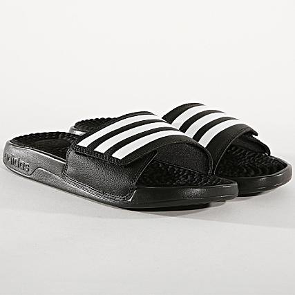 sports shoes b0186 22745 adidas - Claquettes Adissage F35565 Noir Blanc - LaBoutiqueOfficielle.com